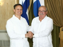 El procurador Jean Rodríguez y el fiscal cubano Darío Delgado Cura.