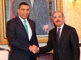 Danilo Medina y el primer minsitro de Jamaica, Andrew Holness.
